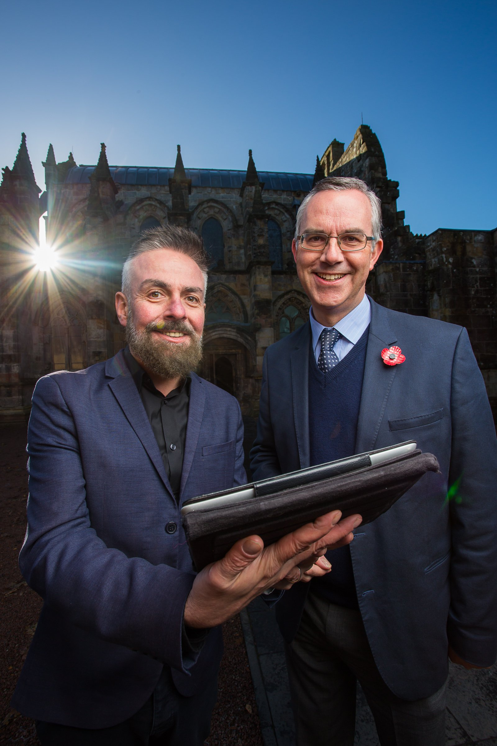 (pictured L-R) Arts & Business Scotland Head of Programmes Carl Watt and Rosslyn Chapel Trust Director Ian Gardner review the new digital toolkit website in front of historic Rosslyn Chapel in Midlothian.